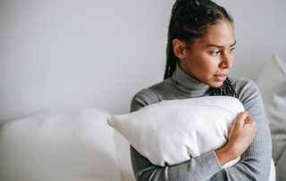 Worried Woman Holding a Pillow
